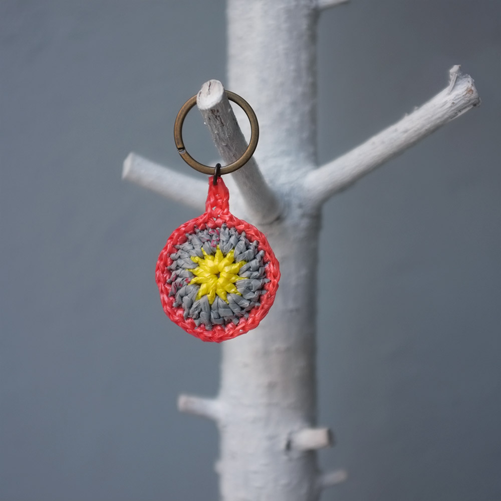 Jura are circular keyrings crocheted from discarded plastic bags.