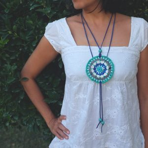 Maala is a neckpiece crocheted from discarded plastic bags.