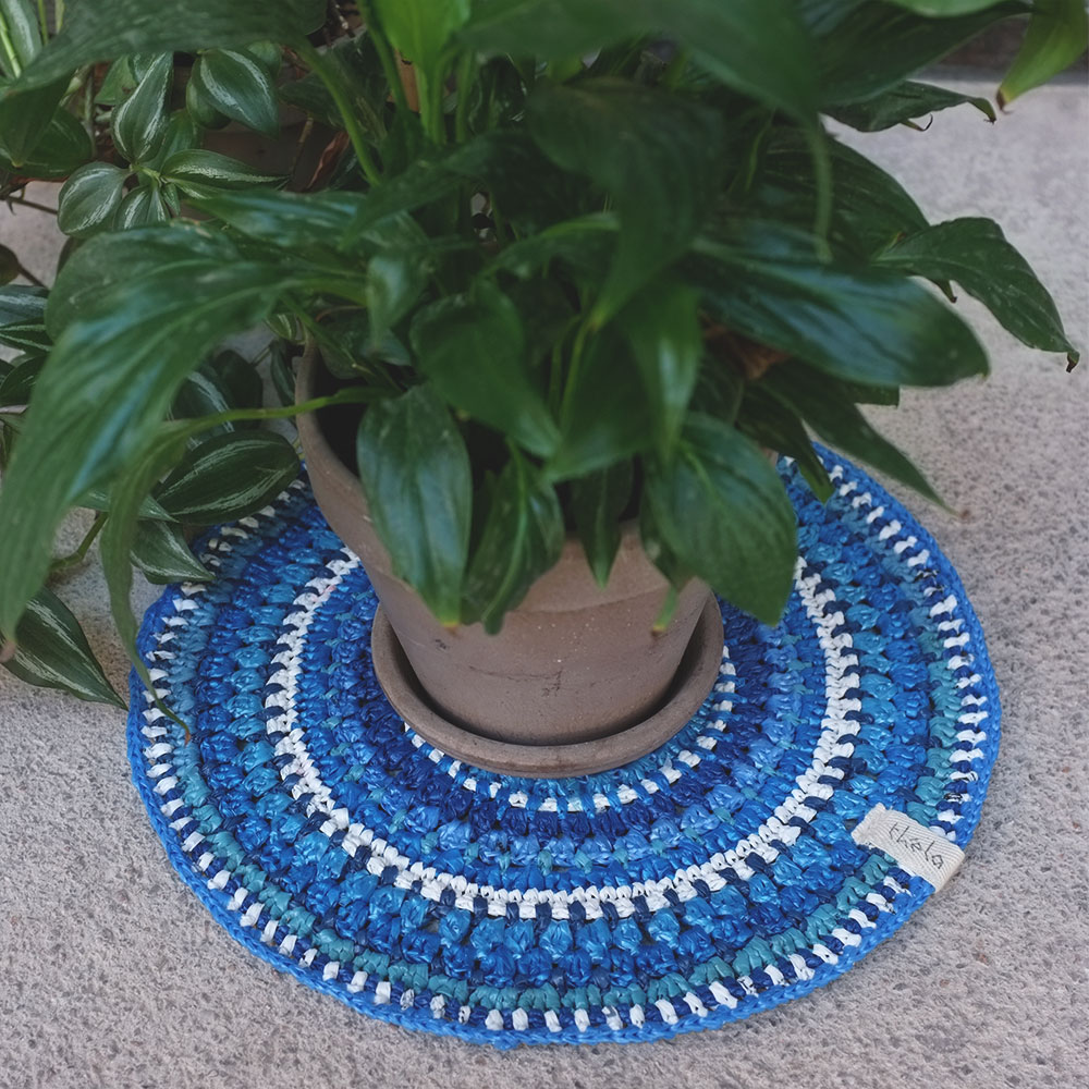 The blue centerpiece is crocheted from discarded plastic bags.