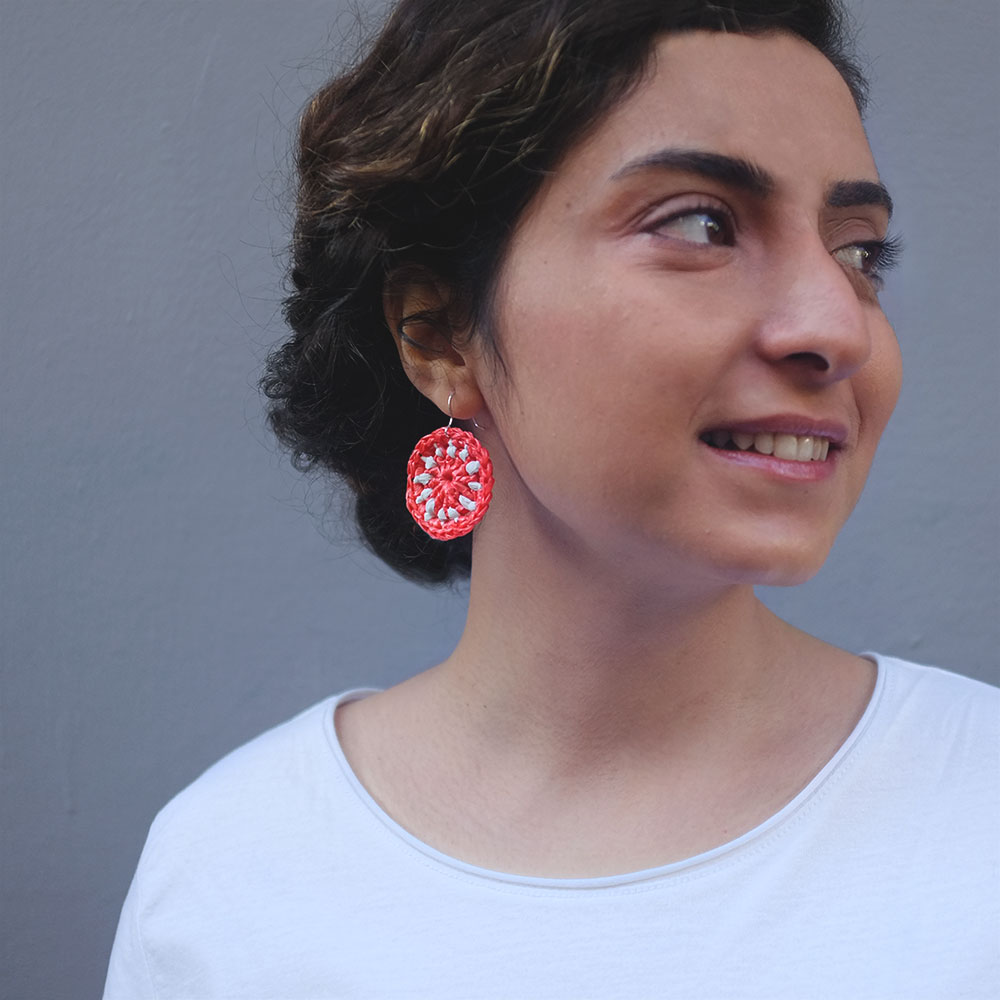 These circular earrings crocheted from discarded plastic bags.