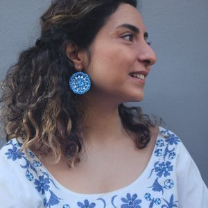 The blue Nafplio Earrings are crocheted in Athens with discarded plastic bags.
